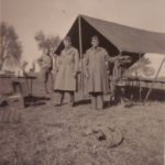 Capt. Lumpkin and two other officers by tent