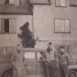 Maj Miller and two others in front of staff car